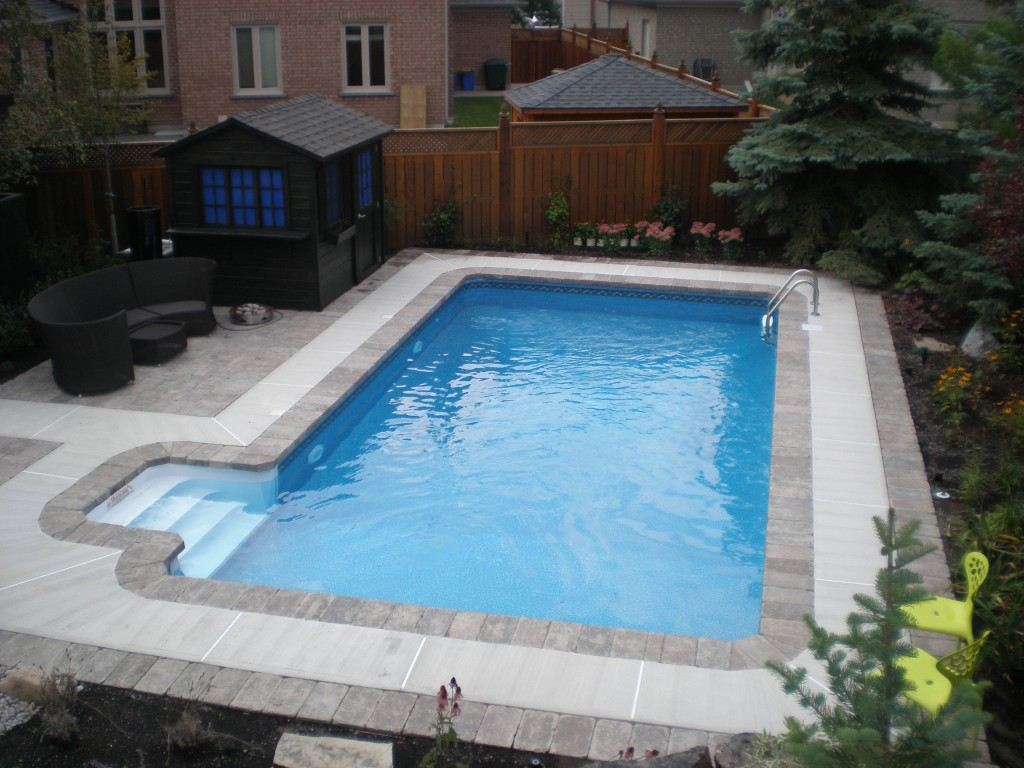 Swimming pool discounterssteel wall in ground pool kits for Pictures of inground pools