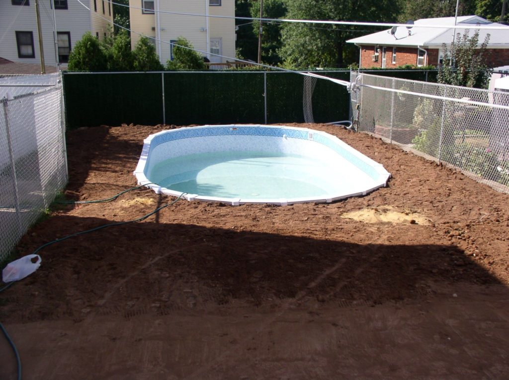 Semi inground oval pool sizes round designs for Above ground pool decks tulsa