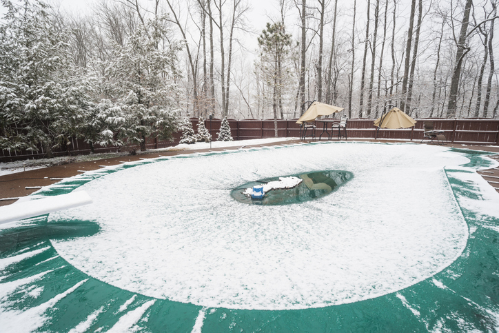 Managing snow and ice on pool cover